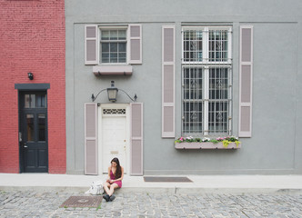 Young woman in front of apartment in the city