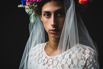Boy with veil and flower crown