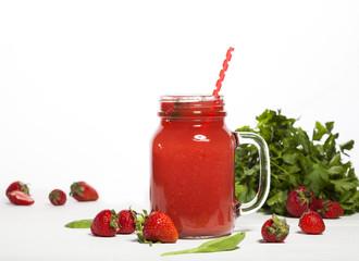 Strawberry smoothie or milkshake in a jar on white background.
