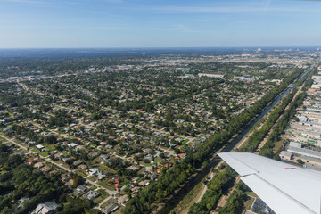 Aerial view of city and gulf Cape Coral, Florida. Typical architecture of South Florida. Large houses built on the banks of canals, canals into the sea.