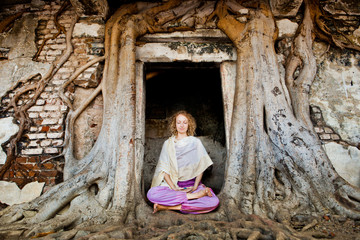 Woman meditating at a temple