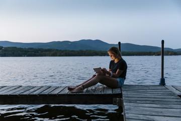 Teen Girl Using Tablet Lakeside