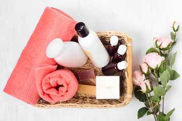 Towel cosmetics spa comb hair lotion candle flowers