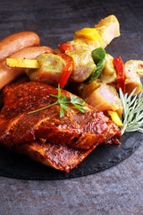 Selection of marinaded meat for bbq grilling with herbs on table