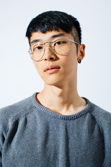 Portrait of an asian trendy man over white background.