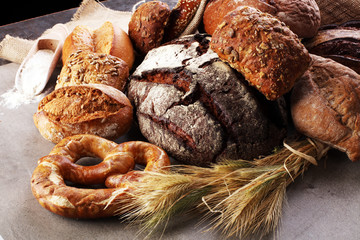 Freshly baked bread. Different kinds of bread and bread rolls on