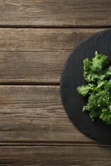 Cropped image of kale on plate over table