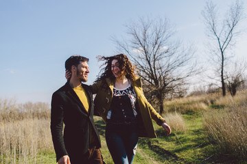 Young couple  laughing on the byway