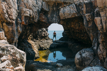 Reflection of a man in a cave