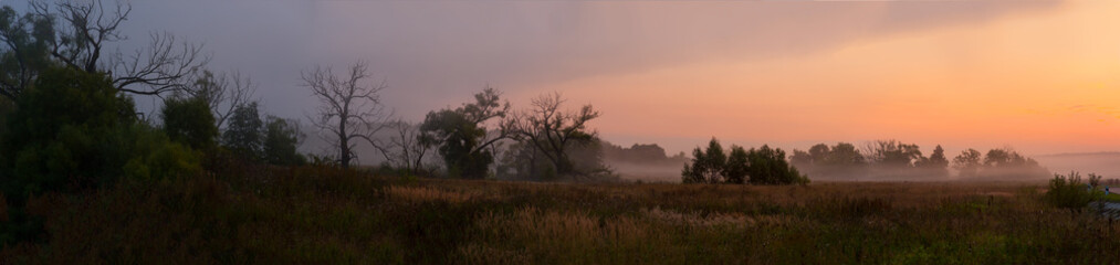 panorama of the misty sunrise of the gentle colors of the nature of the Russian forest-steppe
