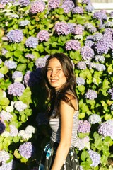 Girl and flowers in sunlight