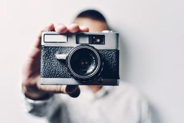 Man holding old camera