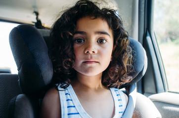 Girl in carseat.