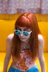 Portrait of ginger girl with sunglasses