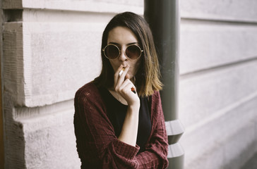 Portrait of the real young woman smoking