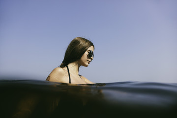 portrait of young woman in the water