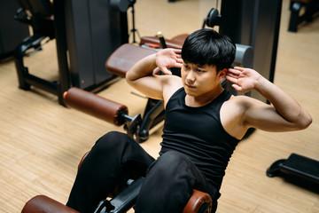 Man doing sit-ups in gym