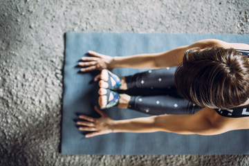 Woman Doing Exercise on the Floor