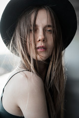 sensual portrait of a beautiful girl in the hat close-up