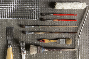 Variety of painting tools on a stone background