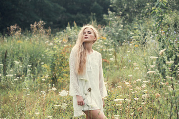 beautiful girl in the summer field