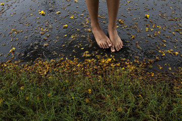 Feet of a teenage girl wet with rain