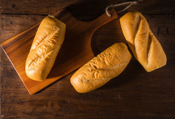 Freshly baked French baguette on table background.
