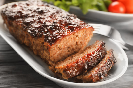Plate with tasty baked turkey meatloaf on table, closeup