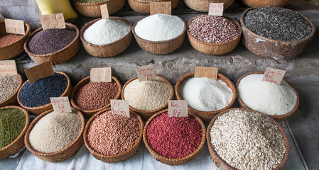 HANOI VIETNAM - AUGUST 2017: Various type of cereal grains (seeds, rice, buckwheat, oats, lentils,chickpeas, beans) on sale at Dong Xuan market