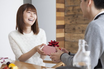 A woman who is happy to be given a gift