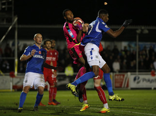 Eastleigh's Reda Johnson and Swindon's Lawrence Vigouroux in action