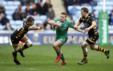 Connacht's Jack Carty is tackled by Wasps' Jimmy Gopperth and Josh Bassett (left)