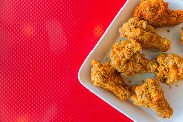 kentucky style fried chicken on red background with space for text