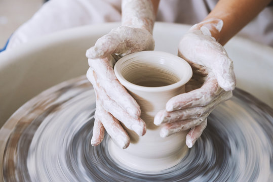 Working on pottery wheel