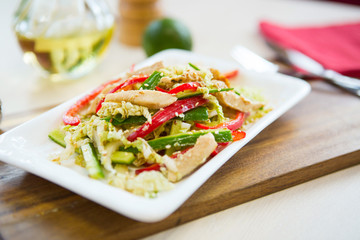Homemade Vegetable salad on a plate on wooden cutting board