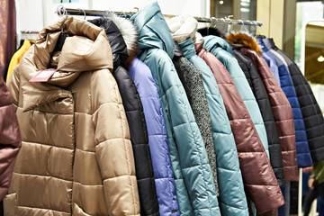 Winter women's jackets on hanger in store