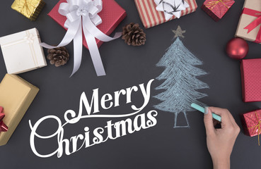 hand draw Christmas tree with decoration and gift box copy space on wooden board.