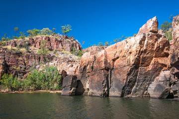Rocky cliff face on the Katherine River banks, the end point of the cruise tour in the dry season at Katherine Gorge in Nitmiluk National Park, Australia.