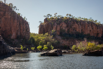 View of the sandstone cliffs at the beautiful Katherine River Gorge in Nitmiluk National Park, Northern Territory, Australia. During the dry season the river is blocked by rocks and vegetation.