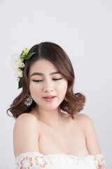 Beautiful asian woman bride on grey background. Closeup portraits with a professional makeup