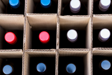 Wine bottles of red and white wine in cardboard case view from top