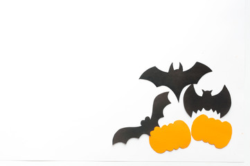 Halloween background, black bats and orange pumpkins on white background,hand made fall decor.