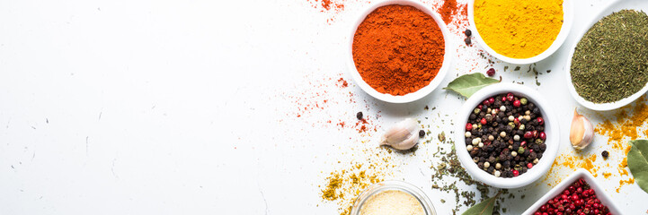 Set of spices in a bowls on white background.
