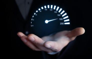 Man holding car speedometer. Speed concept.