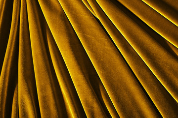 golden color velvet textile photo for background or texture