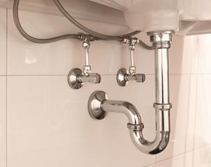 Basin siphon or sink drain in a bathroom