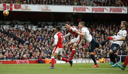 Tottenham's Kevin Wimmer scores Arsenal's first with an own goal