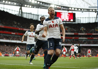 Tottenham's Harry Kane celebrates scoring their first goal from the penalty spot