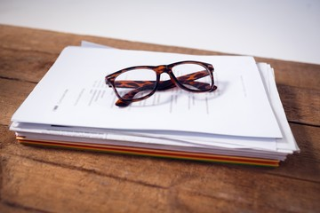Close up of eyeglasses on documents