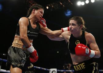 Katie Taylor (R) in action against Viviane Obenauf